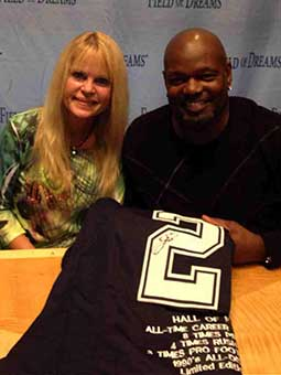 Lyn with Emmitt Smith